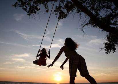 12-istock-Mother-swinging-daughter-Small