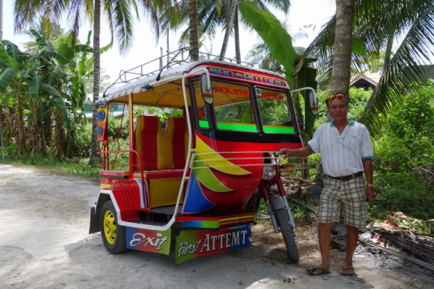 Manong Tobias and his spacious, colorful tricycle