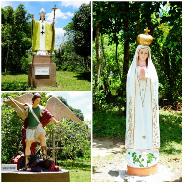 Statues of the Blessed Virgin, St. Michael the Archangel, and Blessed Pope John Paul II